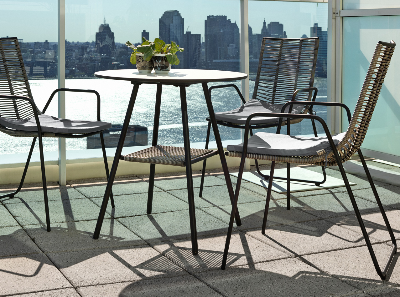 Grey Elba outdoor dining chairs and round outdoor table