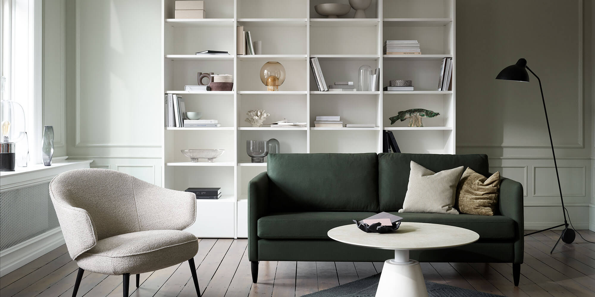 Dark green Indivi sofa and ceramic Madrid coffee table
