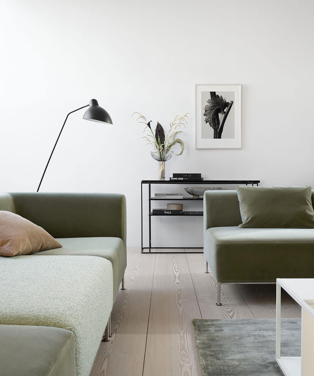 Light green velvet Miami sofa and black Demand floor lamp
