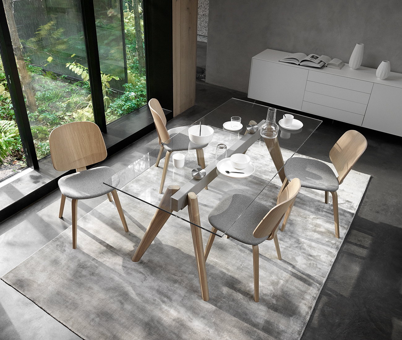 Glass dining table and oak chairs with grey fabric seat