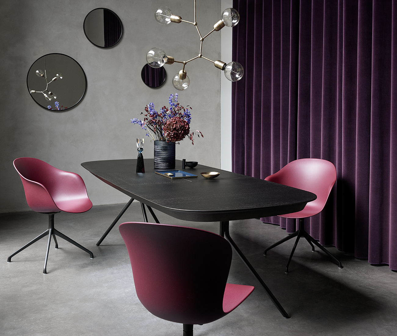 Dark dining table with red Adelaide chairs