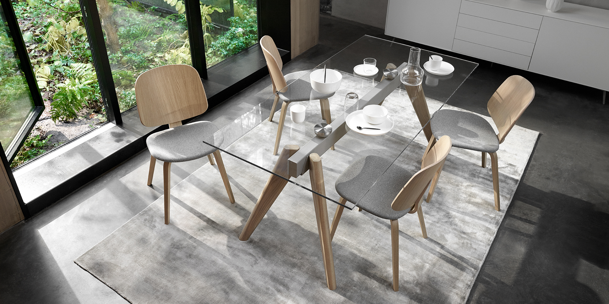Glass table and oak Aarhus chairs with grey seats