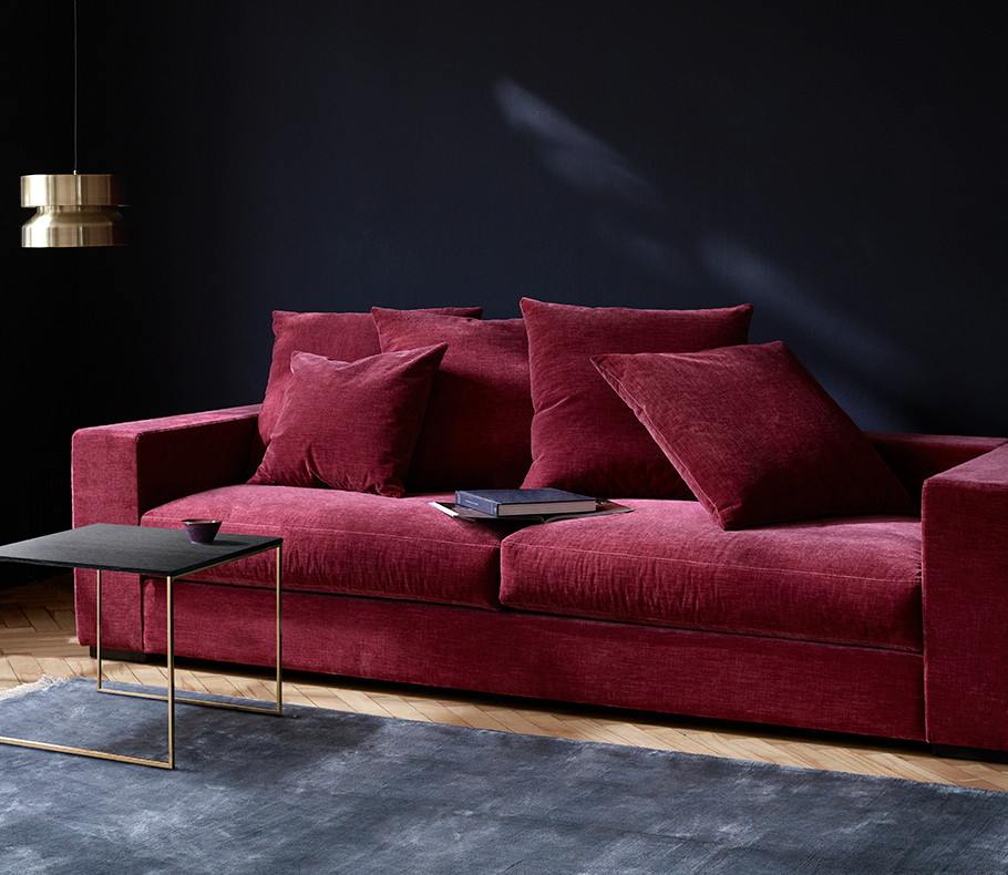 Rustic red velvet sofa