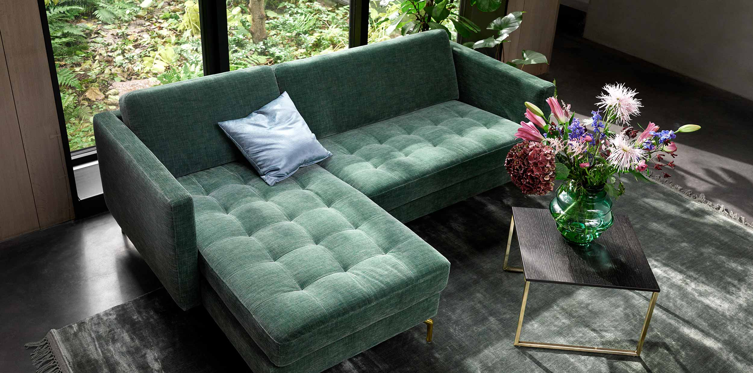 Green Osaka chaiselong sofa and table with flowers