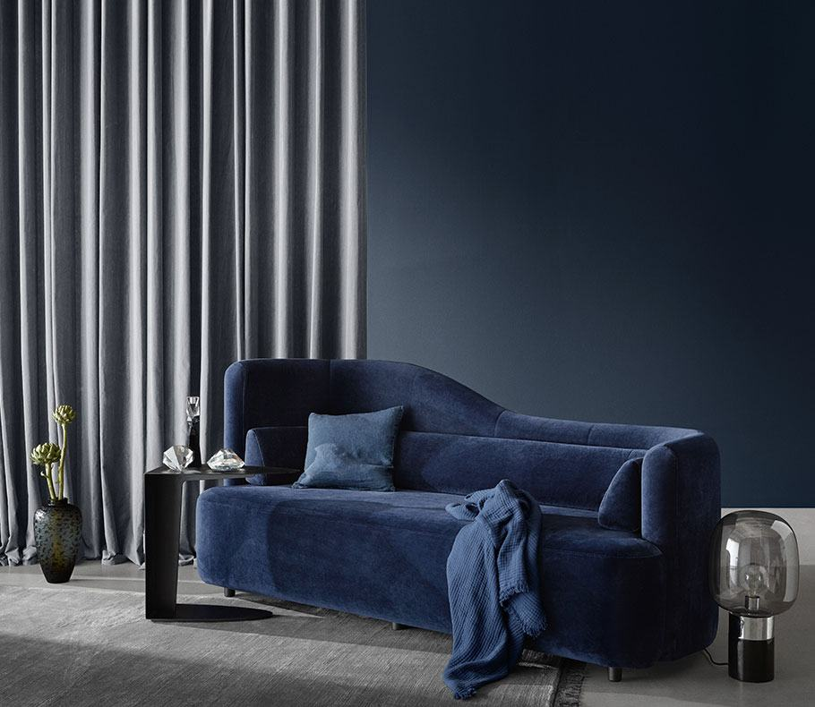 Blue Ottawa sofa with cushion and blanket