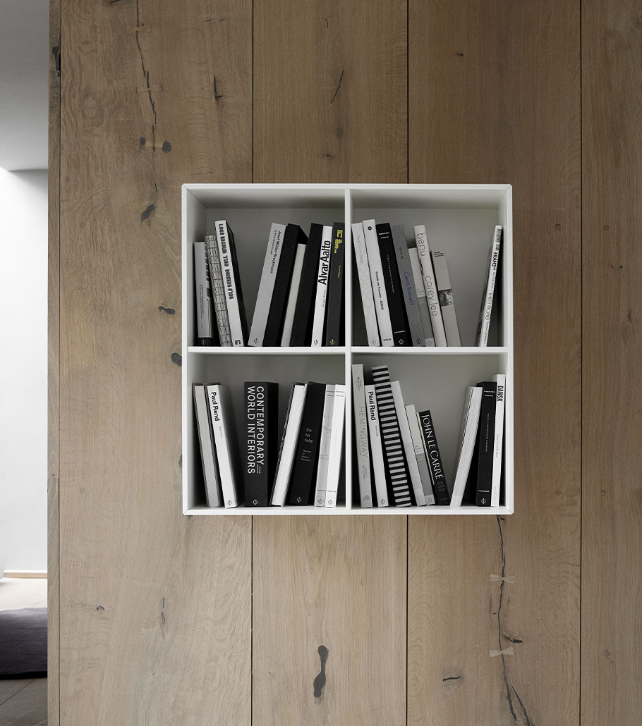 Como bookcase on wall