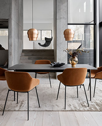 Augusta dining table with dark marble tabletop and Vienna dining chairs in camel cotton