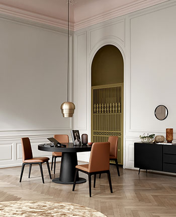 Cognac leather dining chairs and black table