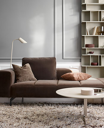 Brown sofa with a white Sevilla coffee table and a light brown rug