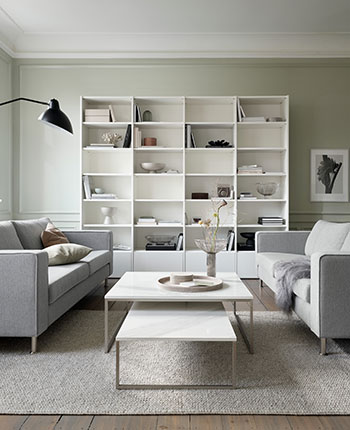 Grey sofa with white coffee table and white wall system