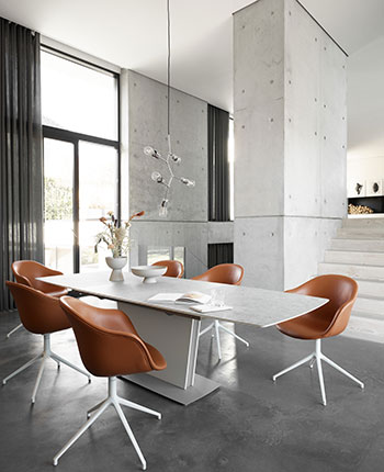 White Milano dining table with Adelaide dining chairs in cognac leather