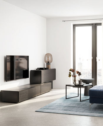 Living room with walnut Lugano cabinet, sofa and sofa table.
