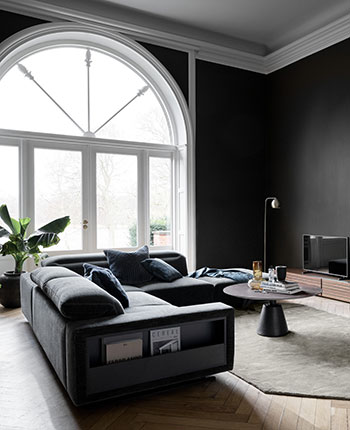 Grey sofa with magazine storage and a black Madrid coffee table