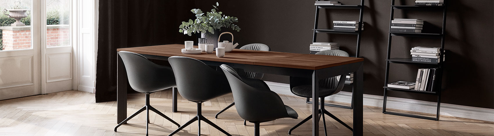 Lyon dining table with walnut veneer table top and black Adelaide dining chairs