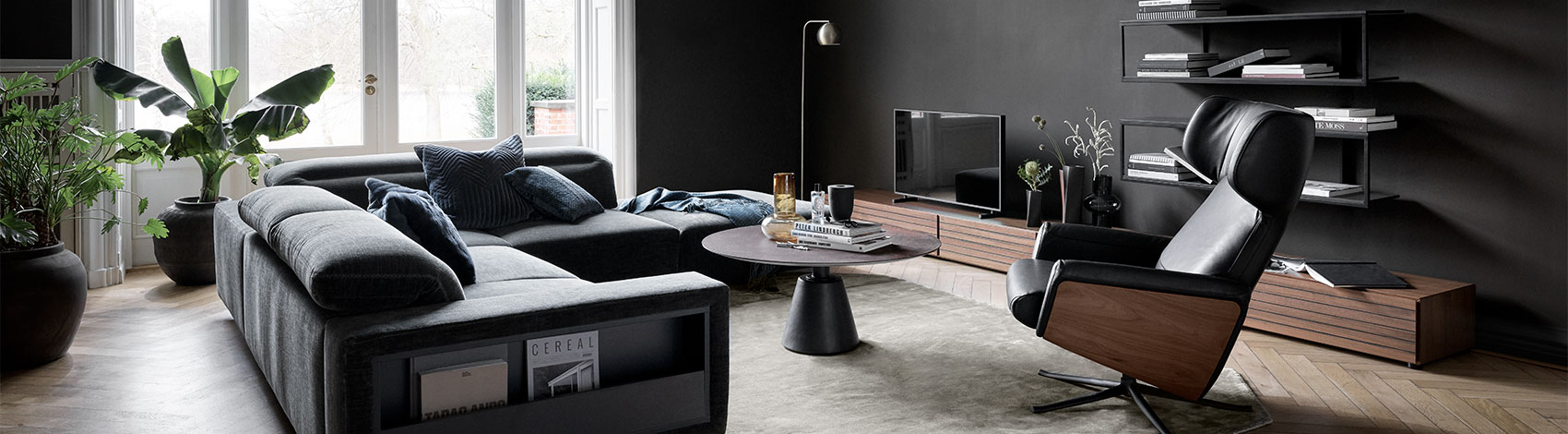 Dark grey sofa with magazine storage and black/walnut veneer recliner