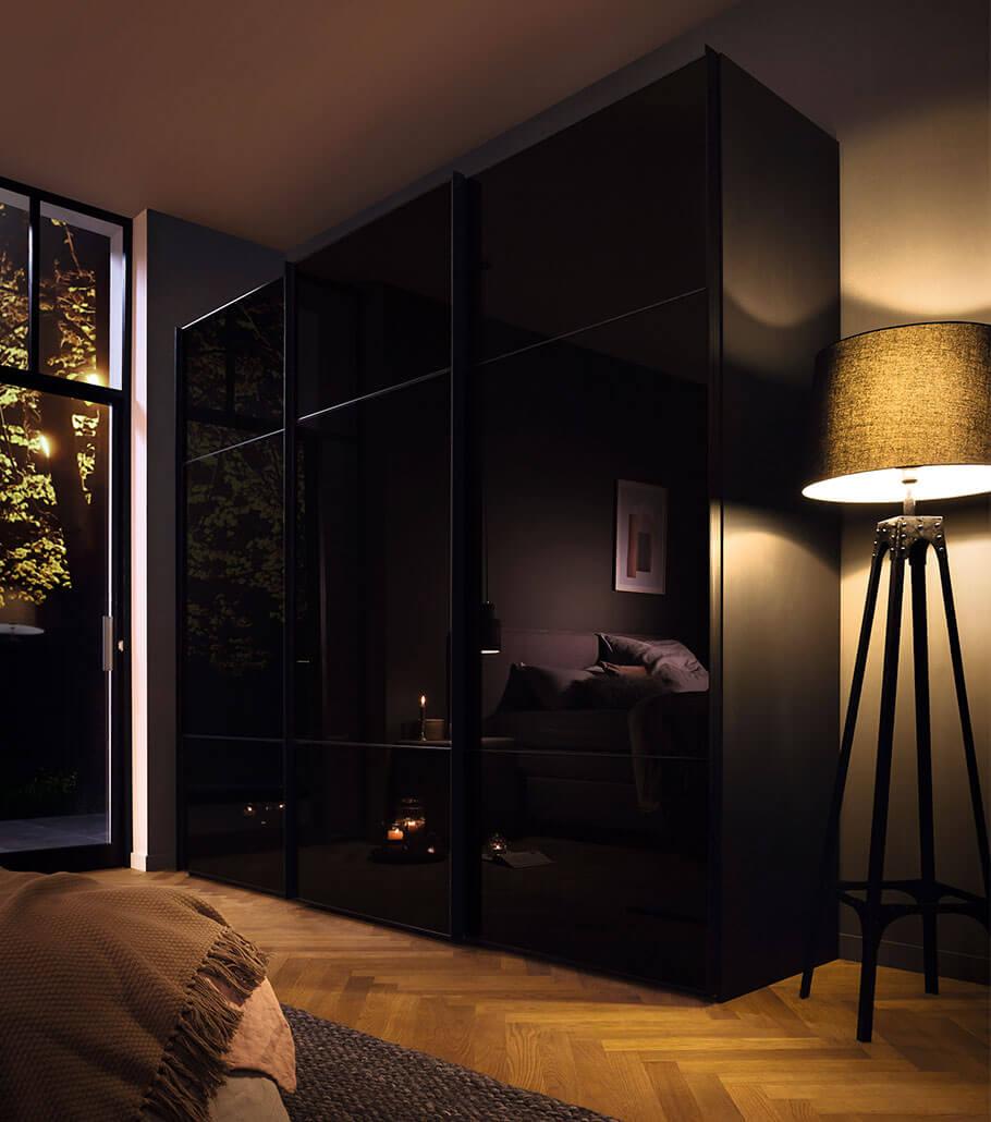 Dark wardrobe in bedroom