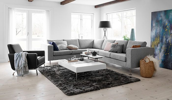 Grey corner sofa and black chair in living room