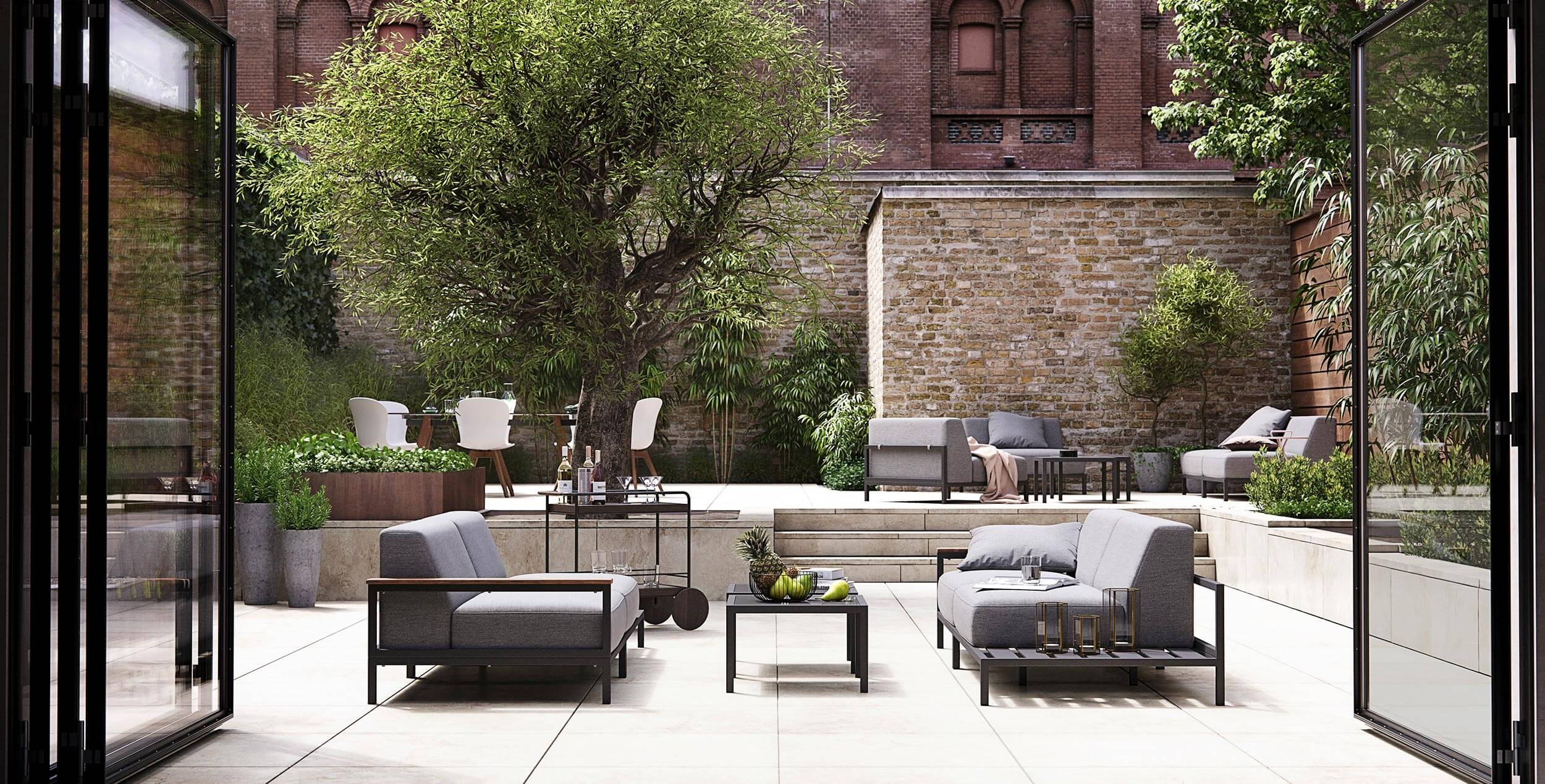 BoConcept's Rome garden sofa system and Adelaide table and chairs in walled terrace garden