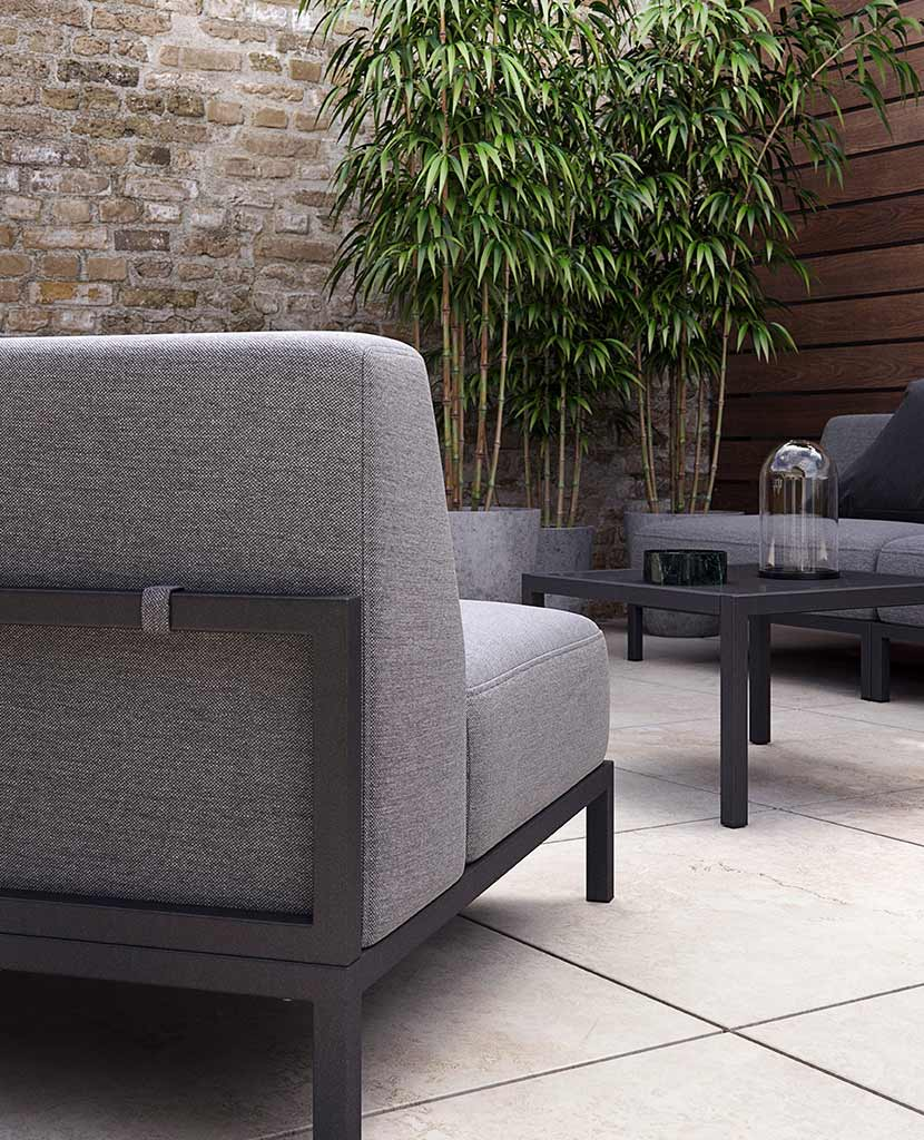 BoConcept's Rome garden sofa system in walled terrace with plants