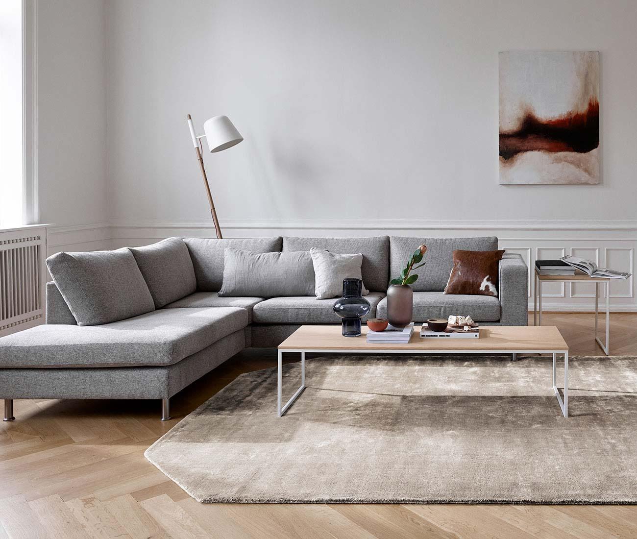 Un canapé d'angle en tissu ou en cuir ?