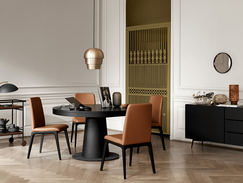 Round table with extension in espresso oak and chairs with brown leather and black legs. And a sideboard in espresso oak.