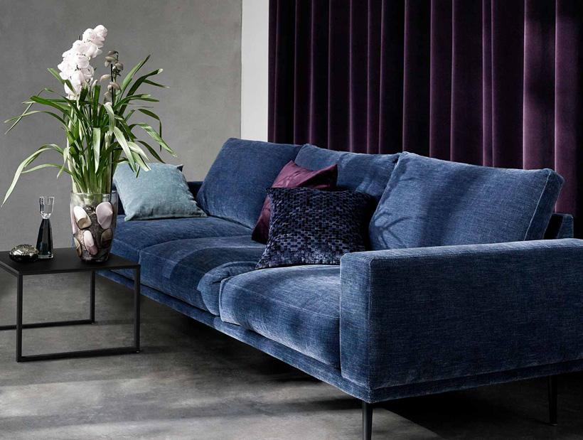 Dark blue velvet sofa with black Lugo side table