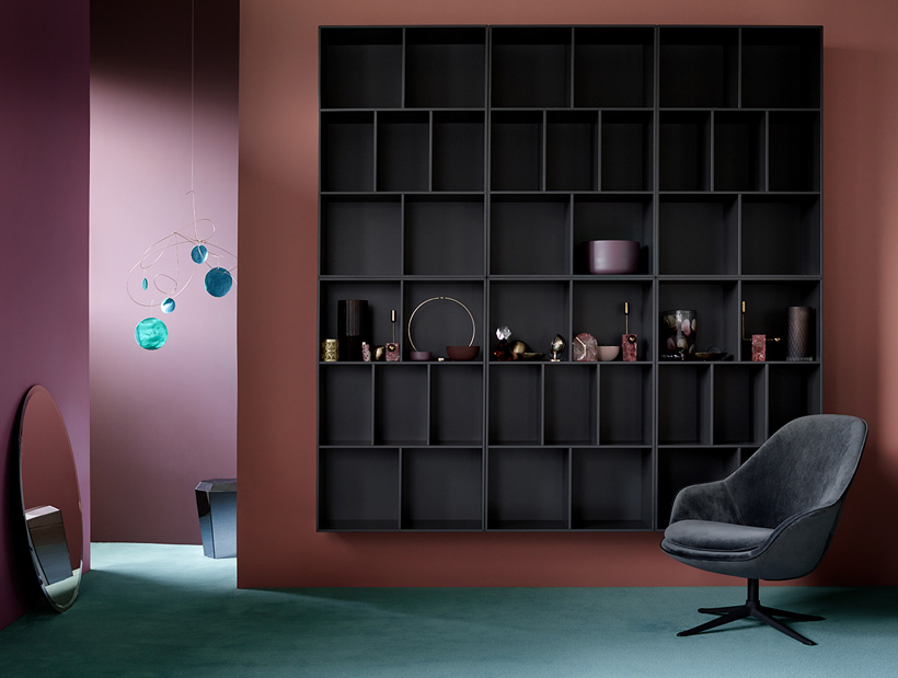 Black Como wall system and a grey velvet Adelaide armchair