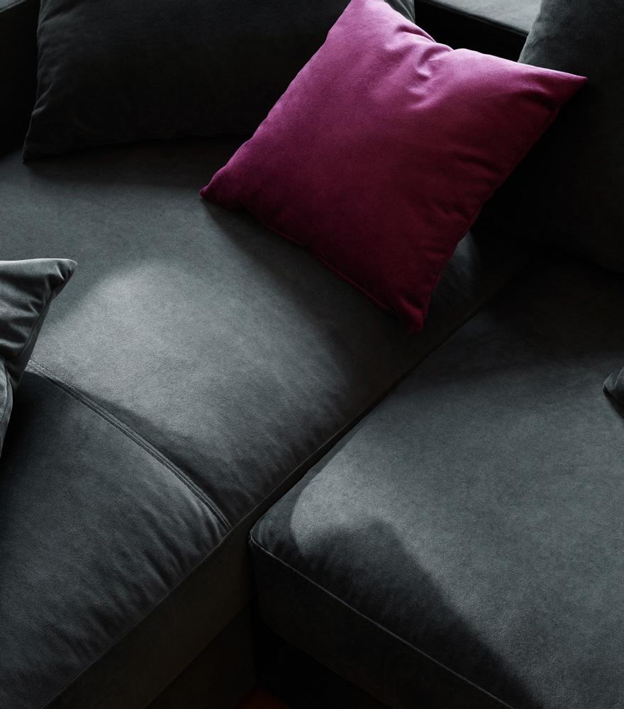 Dark grey sofa with purple cushion