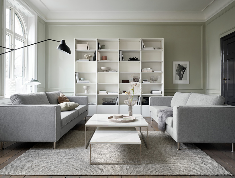 White Copenhagen wall system and light grey sofas with white Lugo coffee tables