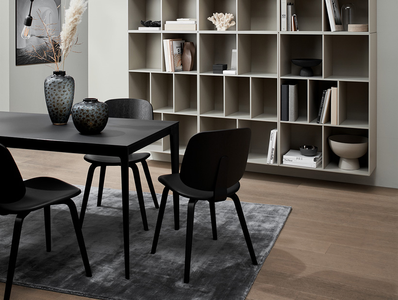 Ash grey Copenhagen wall system and black Torino dining table with black Aarhus chairs