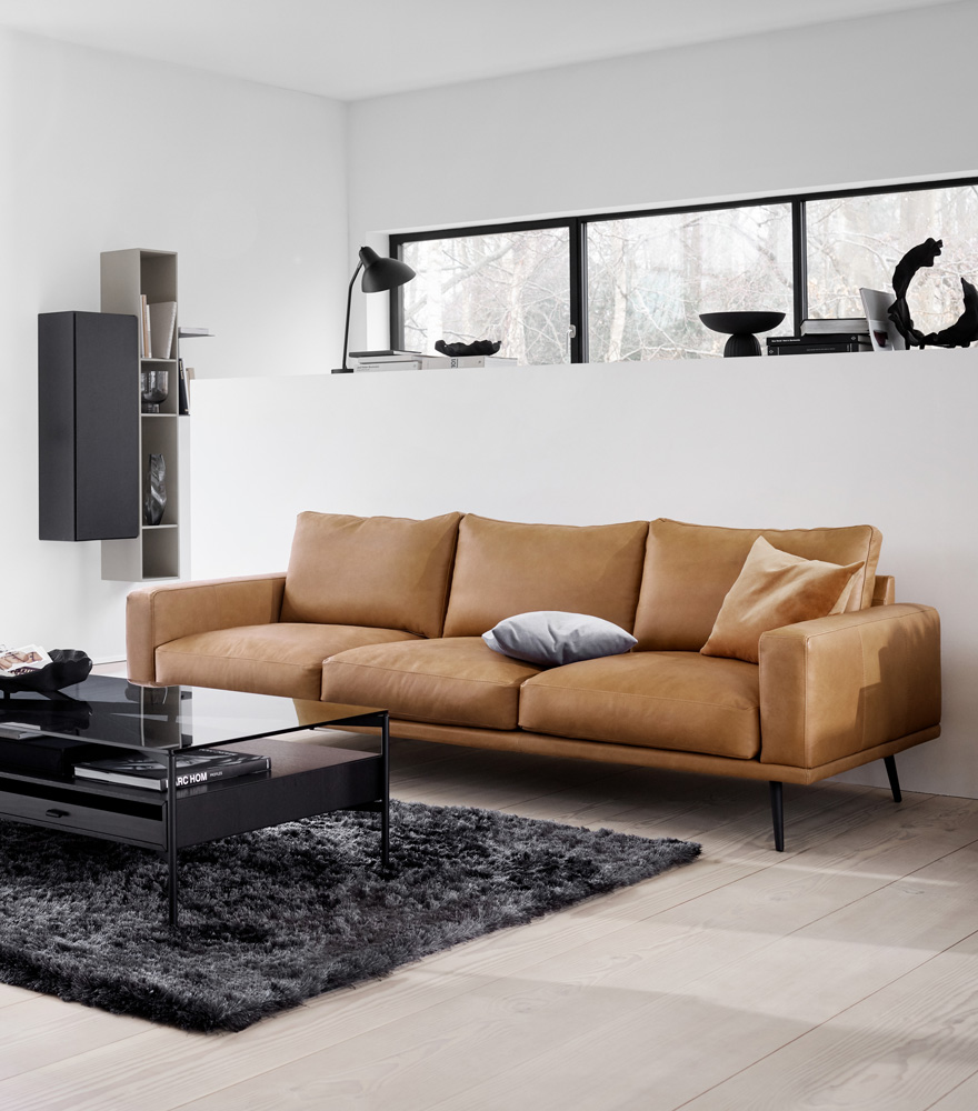 Carlton sofa in brown leather and black Los Angeles coffee table and steel Beijing Rug