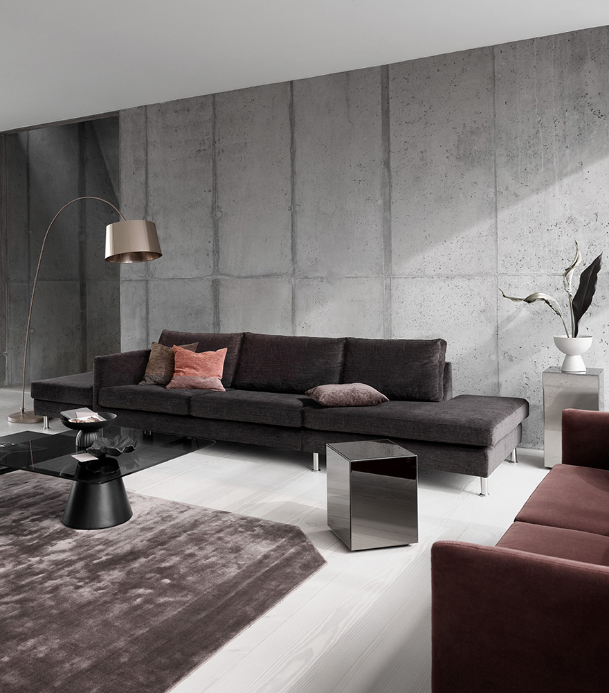 Indivi Sofa in dark brown and dusty red with black Madrid coffee tables and a Block mirror table
