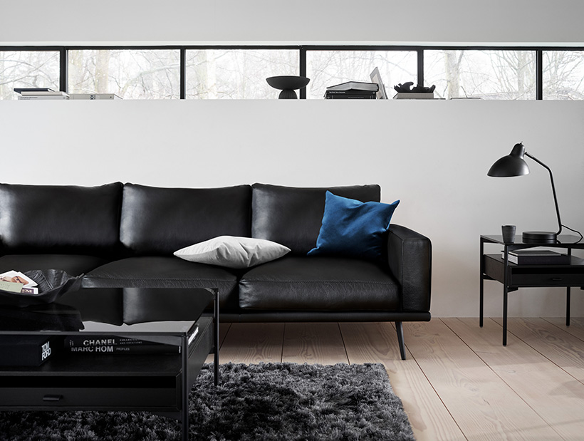 Carlton sofa in black leather with black Los Angeles coffee and side table and Beijing rug in steel