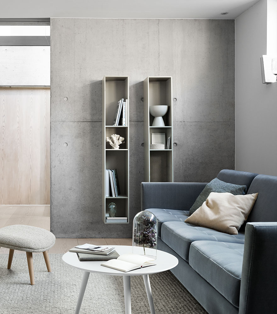 Dusty blue Indivi Sofa and ash grey wall system and Bornholm coffee table