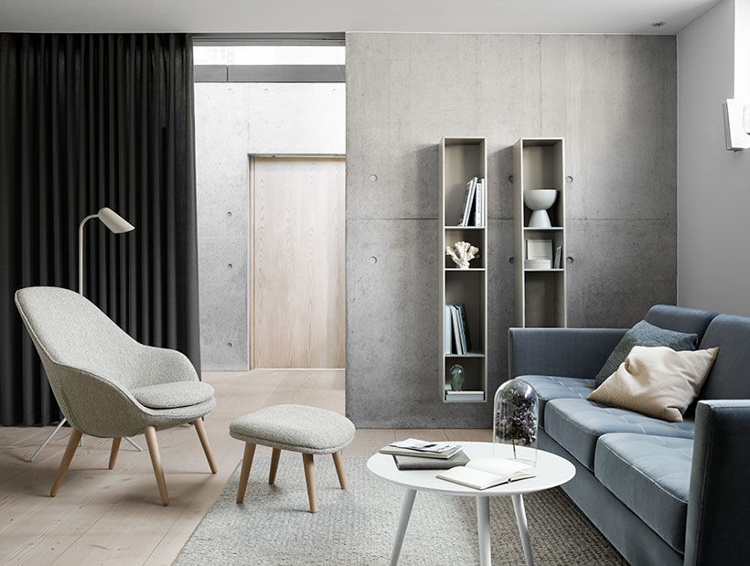 Light grey Adelaide chair and footstool and dusty blue Indivi Sofa and ash grey wall system
