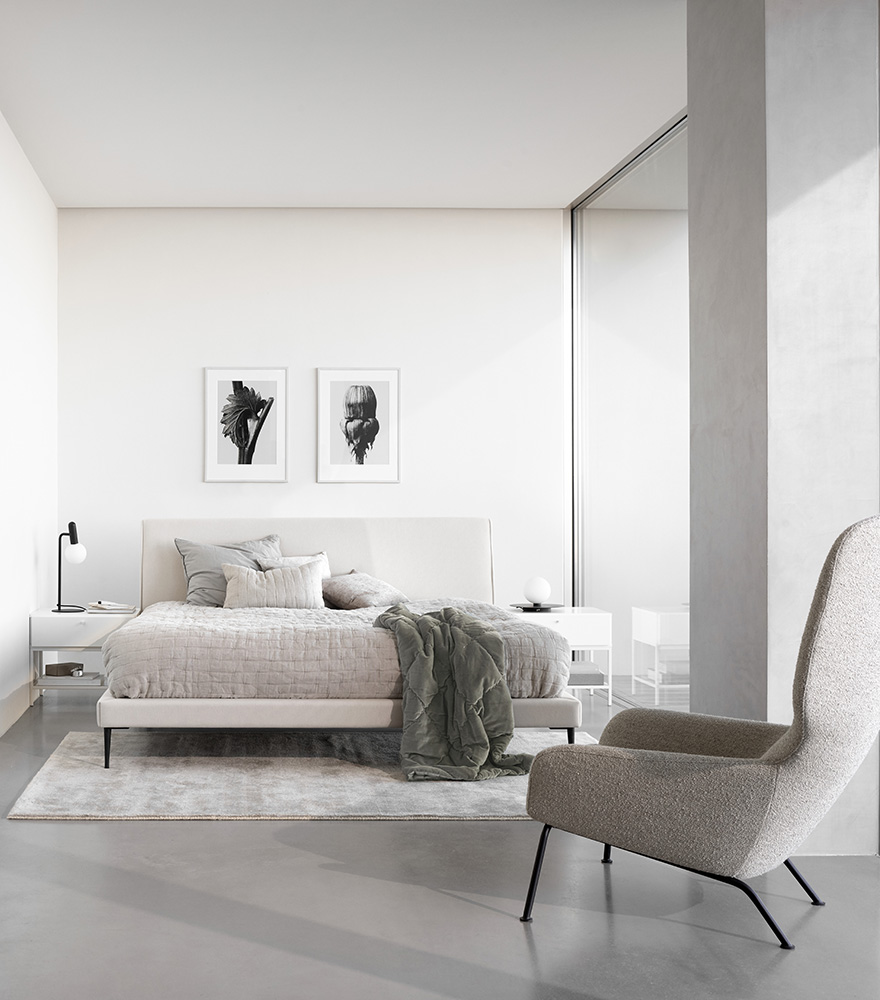 Arlington bed in white with REMS beige bedspread and Bordeaux night stands in white and Dublin chair in beige