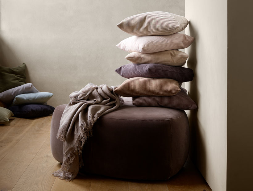 Stack of cushions on Bermuda footstol
