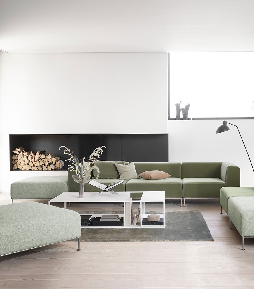 Green sofa and white coffee table