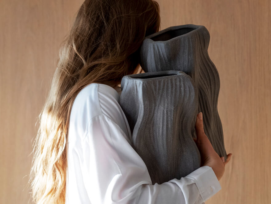 Woman holding vases