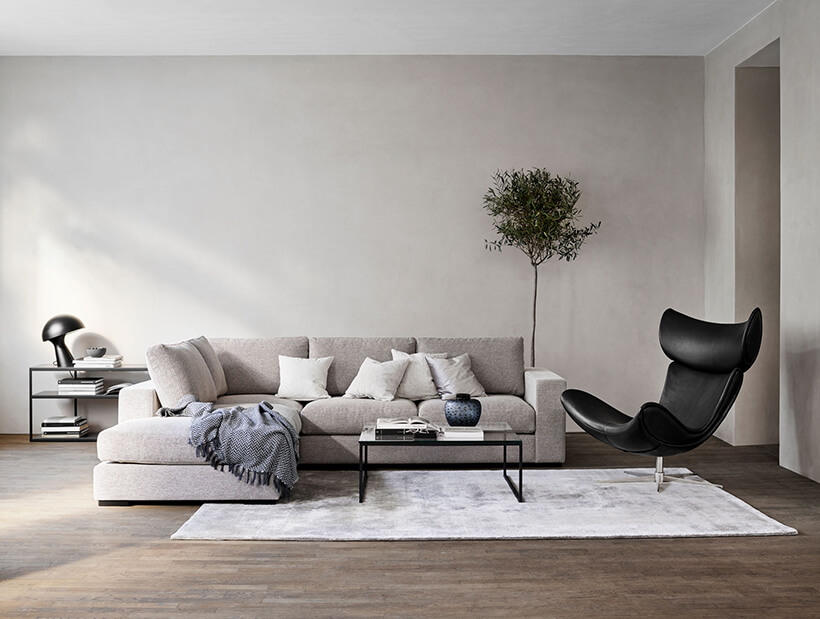 Imola chair next to sofa in living room