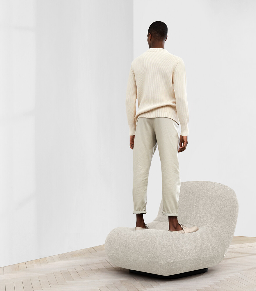 Man standing on Chelsea chair