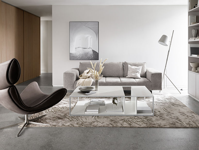 Brown Imola chair and grey sofa