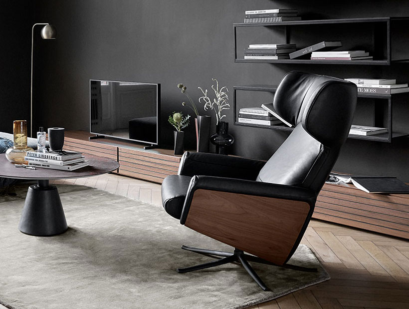 Lucca chair in living room with shelves and TV in the background