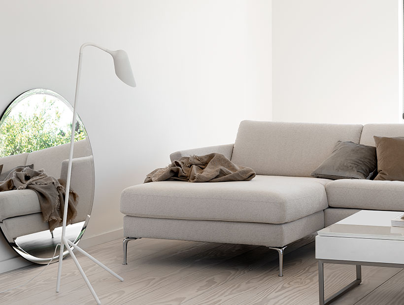 Bright room with a tone mirror and light coloured sofa
