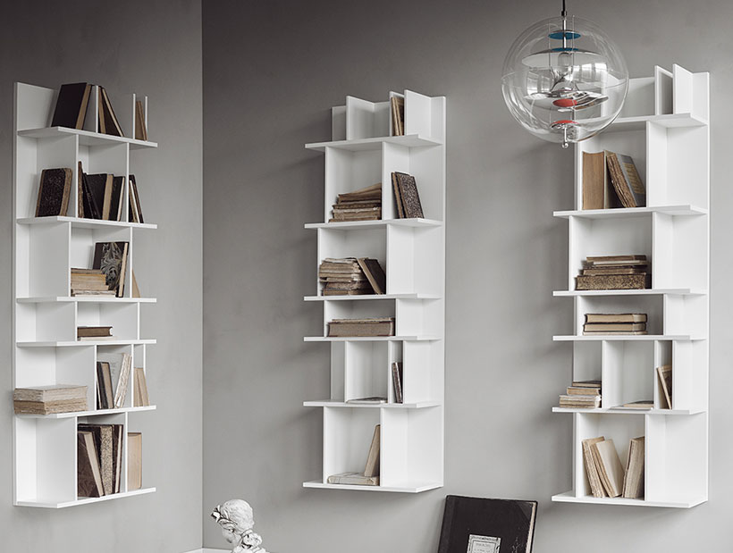 Three white Como wall systems hanging on wall for book storage