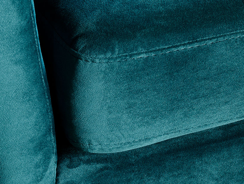 Close up of green velvet felt sofa