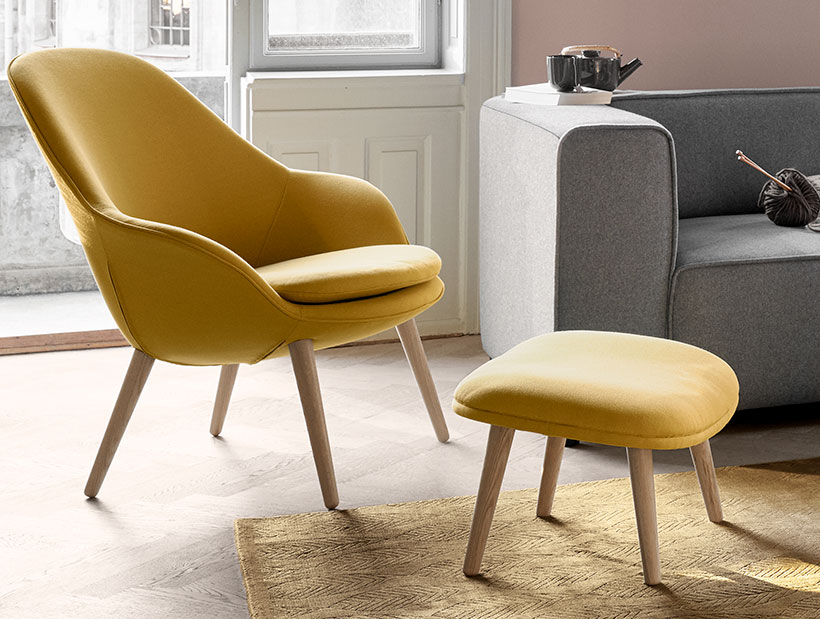 Yellow Adelaide chair and footstool with oak legs