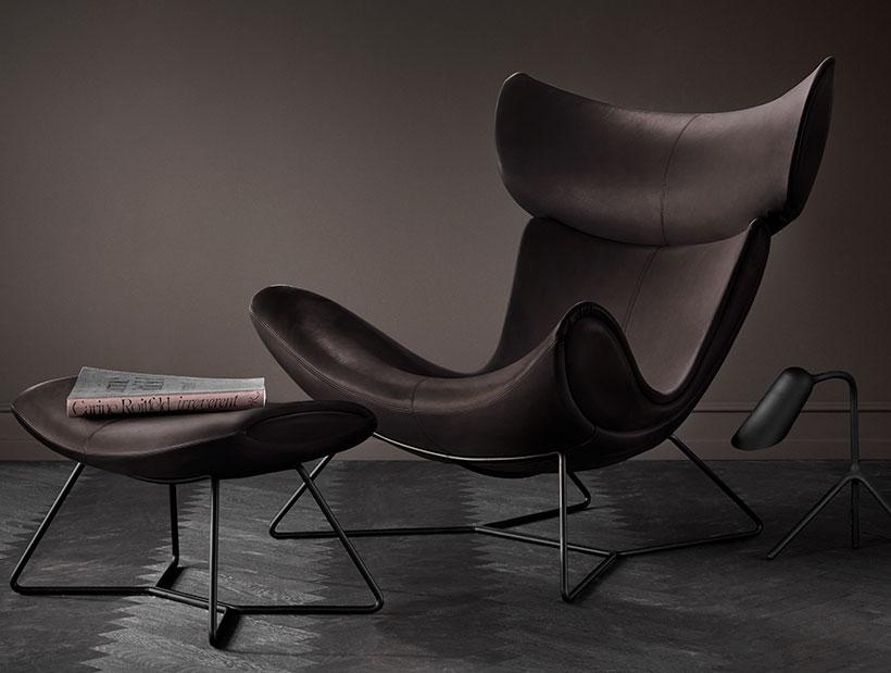 Black Imola chair footstool in a dark setting