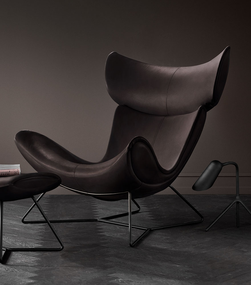 Black Imola chair footstool in a dark setting